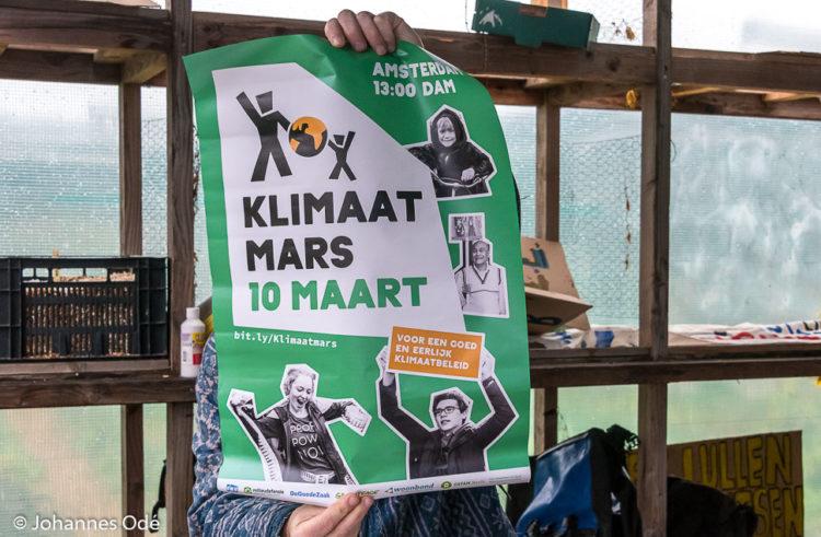 Spandoeken en borden voor Klimaatmars